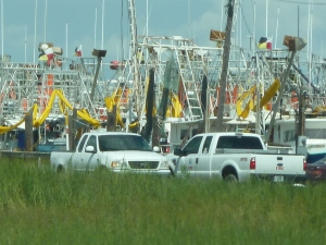 Shrimp boats with oil booms